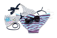 Sunglasses to rest upon swimsuit Royalty Free Stock Image