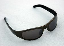 Sunglasses on to snow stock photos