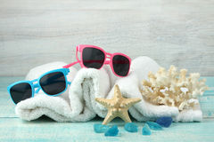 Sunglasses,  towel, crystals, coral and starfish Stock Photo