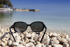 Sunglasses on a tropical beach Stock Photography