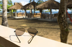 Sunglasses in tropical resort Royalty Free Stock Images