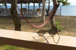 Sunglasses in tropical resort Stock Photos