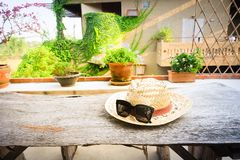 Sunglasses with vintage straw hat fasion on wooden table, Blur background for vintage resort hotel. Concept Summer royalty free stock photos