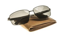 Eyeglasses and wallet isolated on white background. Sunglasses and wallet isolated on white background Stock Photo