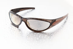 Sunglasses. With water drops on silver stock images