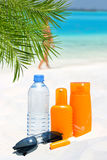 Sunglasses, water and sun protection cream Royalty Free Stock Image