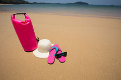 Sunglasses, Waterproof bag, straw hat and flip flops on tropical Stock Photo