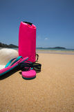 Sunglasses, Waterproof bag, straw hat and flip flops on tropical Royalty Free Stock Photos