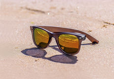 Sunglasses on wet sand, beach Royalty Free Stock Images