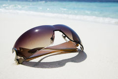 Sunglasses on white sand Royalty Free Stock Photography