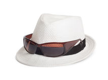 Sunglasses and a white summer hat on  background Royalty Free Stock Images