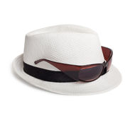 Sunglasses and a white summer hat on  background Royalty Free Stock Photo