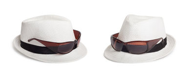 Sunglasses and a white summer hat on an isolated background Stock Photo