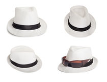 Sunglasses and a white summer hat on an isolated background Royalty Free Stock Photo