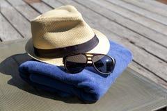 Sunglasses and white sunhat. Stock Image