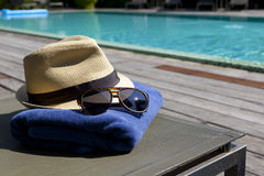 Sunglasses and white sunhat. Stock Photography