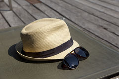 Sunglasses and white sunhat. Royalty Free Stock Photography