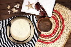 Sunglasses and wicker hat Stock Images