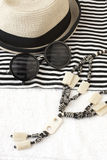 Sunglasses and wicker hat Royalty Free Stock Image