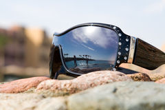 Sunglasses With Reflection Of Sea Royalty Free Stock Photography
