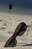 Sunglasses of a woman on the beach Stock Photography