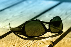 Sunglasses on wood Royalty Free Stock Images