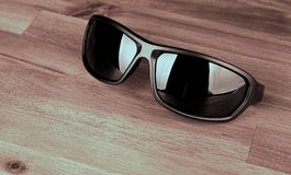 Sunglasses on wood. Sunglasses on a wood surface Royalty Free Stock Photography