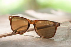 Sunglasses on wood table. Stock Images