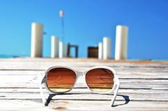 Sunglasses on the wooden jetty Stock Image