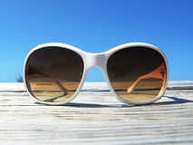 Sunglasses on the wooden jetty Royalty Free Stock Photos