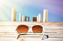 Sunglasses on the wooden jetty Stock Photography