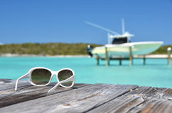 Sunglasses on the wooden jetty Royalty Free Stock Photo