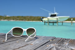 Sunglasses on the wooden pier Royalty Free Stock Images