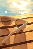 Sunglasses on wooden planks Stock Photography