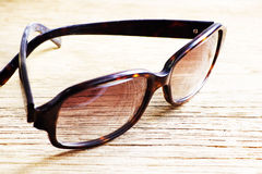 Sunglasses on a wooden table closeup Royalty Free Stock Photos