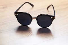 Sunglasses on wooden table Royalty Free Stock Photos