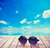 Sunglasses on wooden table Royalty Free Stock Images
