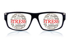 Sunglasses with the word stress in place of the eyes royalty free stock photography
