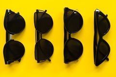 Sunglasses on Yellow background empty space royalty free stock photo