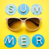 Sunglasses on yellow background and text summer. Top view. Holidays and vacation concept royalty free stock images
