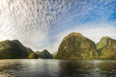 Sunglow in Middle Earth fantasy land. Interesting Mountain Range at Doubtful Sound that looks like a fantasy land. Numerous locations in Fiordland National Park Royalty Free Stock Photography