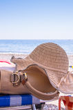 Sunhat and handbag on a beach Stock Photos