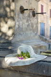 Sunhat with real flower on a Provencal fountain in Porvence, Fra Royalty Free Stock Image