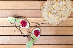 Sunhat and sandals. Straw sunhat and pretty sandals on cedar deck Royalty Free Stock Photo