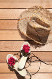 Sunhat and sandals Stock Photography