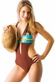 Sunhat and summer. Pretty model poses in one-piece and holds up her sunhat Royalty Free Stock Image