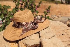 Sunhat. Wide brimmed sunhat resting on a rock in the sunshine Royalty Free Stock Images