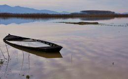 Sunk boat on a lake in Italy  Royalty Free Stock Photography