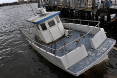 Sunk boat in the Sheepsheadbay channel. BROOKLYN, NY - OCTOBER 29: Sunk boat in the Sheepsheadbay channel due to impact from Hurricane Sandy in Brooklyn, New Royalty Free Stock Photo