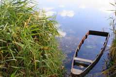 Sunk boat. Submerged boat at the edge of a river Stock Image